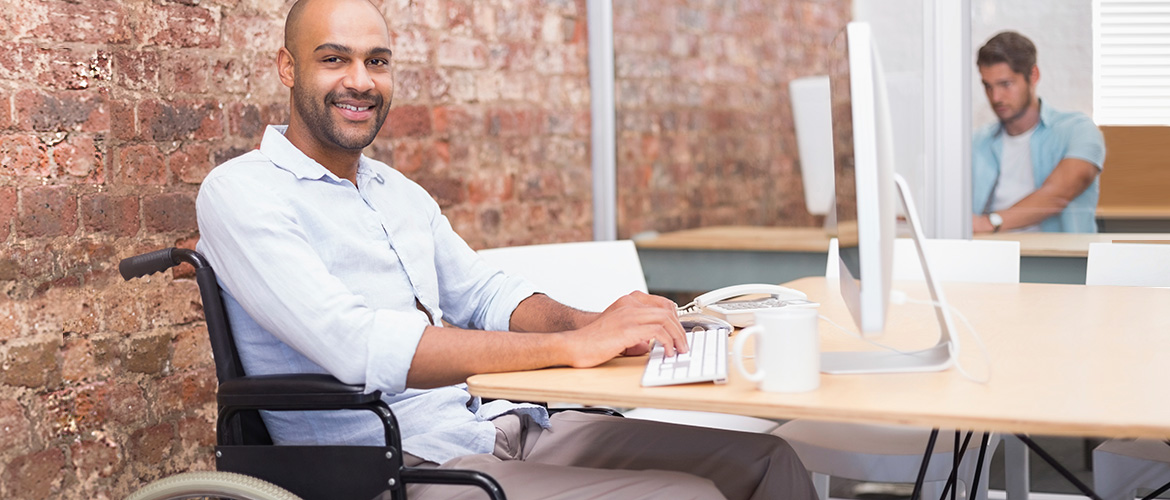 man at desk in wheelchair